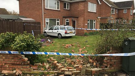 The scene of a crash in High Road, Trimley St Mary, where a car crashed through a garden wall and in