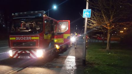 Firefighters in West End Road, Ipswich after recovering an item from the River Orwell as part of a p