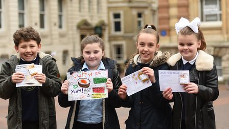 Pupils from Whitton Primary School spent Monday morning in Ipswich selling spicy recipe cards. L-R R