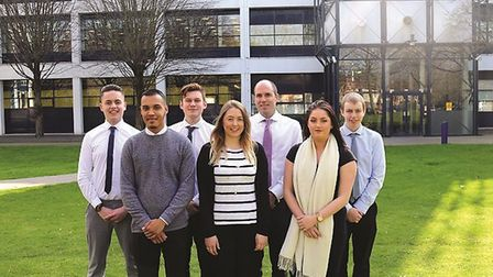 Sanctuary Personnel, Ipswich James Rook with six of the company�s current apprentice
