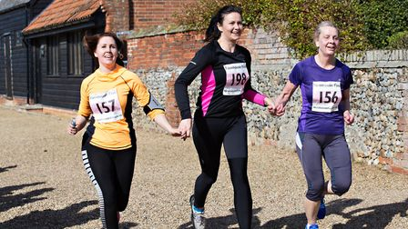 Faye Gaffer, Anne-Marie Williams and Edwina Frost crossed the line together.