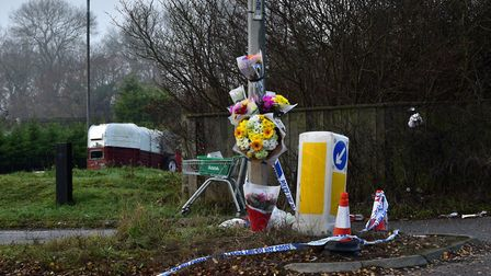 Floral tributes left at the entrance to West Meadows Travellers' Site in the wake of the deaths of N