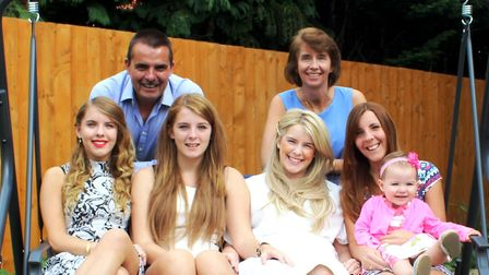 Sandy Mansfield (far right) with her four daughters and husband. Picture: PARKINSON'S UK