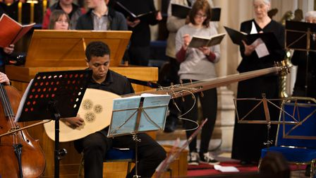Instrumentalist from the Ravenscroft Consort playing a 17th Century reconstructed theorbo. Picture: