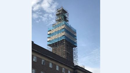 Scaffolding at the Norwich city centre clock tower, which appears to have been draped in the blue an