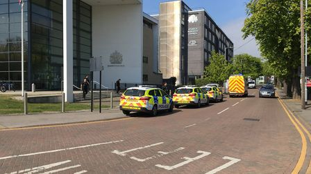 Police vehicles at Ipswich Crown Court on April 20, 2017 after a man threatened staff. Picture: GEMM