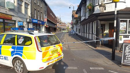 Forensic police investigate the scene of the alleged stabbing in Dogs Head Street in Ipswich town ce