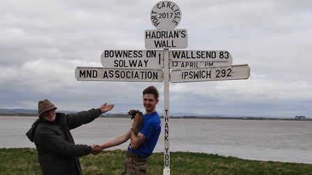 Charlie and Rodger, a local man who changed his famous sign to point towards Ipswich. Picture: ADVEN