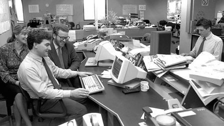 The newsroom at BBC Radio Suffolk in 1990 with journalists Kevin Burch (left foreground) and John Cr