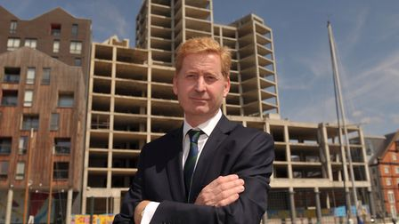 Developer John Howard with the 'Winerack ' building on the Ipswich Waterfront.
