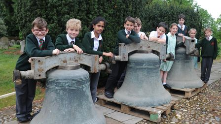 Children from St Margaret's Primary School watch the bells being loaded onto a truck. Picture: SARAH