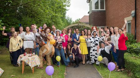Team members and residents at Bucklesham Grange celebrating with the Hallmark Care Homes directors.