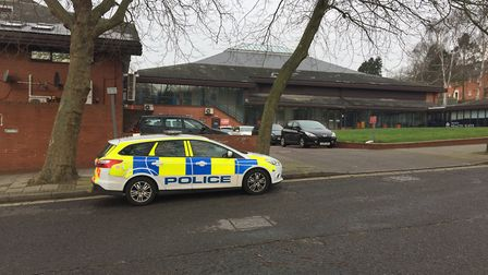 A police car sits outside Crown Pools after an incident.