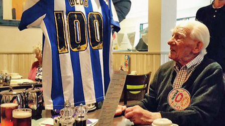 Jesse Webb receives a Sheffield Wednesday shirt on his 100th birthday from his oldest great-grandson
