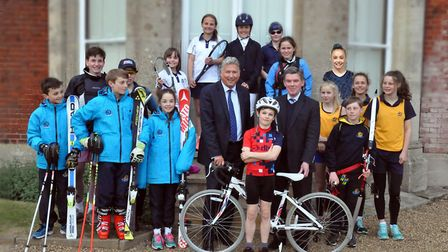 Adrian Brown, headmaster of Orwell Park, with Sir Hugh Robertson, surrounded by school athletes who