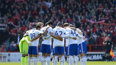The Ipswich team huddle up before kick-off at Nottingham Forest