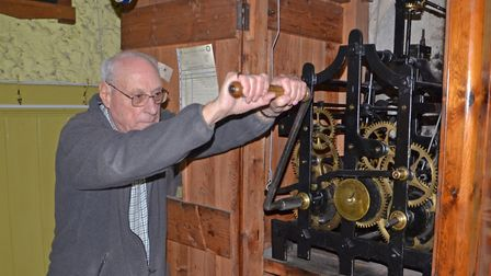 John Girt manually winding the clock at St Margaret's Church in Ipswich. Picture: DAVID EVANS