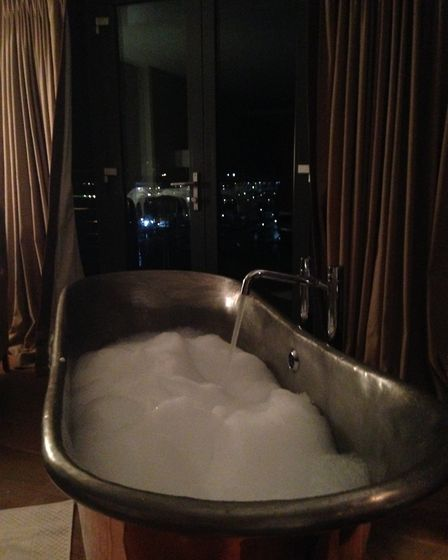Our room at the Salthouse had a luxurious copper bath, with views overlooking the harbour. Picture: