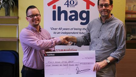 Fleximize area business development manager Matthew Pearce presenting a cheque to Halford Hewitt, ch