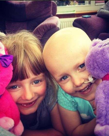 From left to right: Jessica Bendall, now seven, with younger sister Hayley, who is battling cancer.