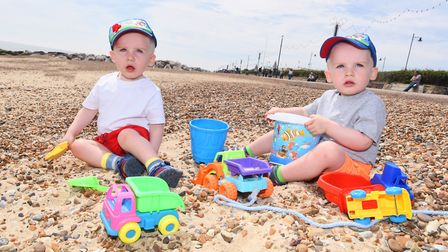 Left to right, Zak Dean and Jay Dean, making the most of the sunshine at the beach. Picture: GREGG B