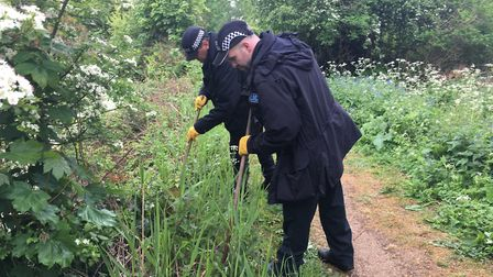 Police officers conduct a search for weapons around Alderman Road Recreation Ground in Ipswich. Pict