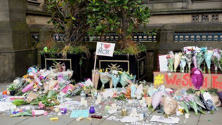 Floral tributes left by Manchester Town Hall after a suicide bomber killed 22 people leaving a pop c