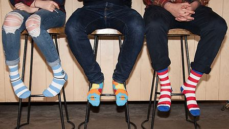 A selection of cotton Stand 4 Socks, which are sold to support UN global goals, there are 11 goals i