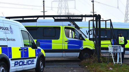 A heavy police presence at the gate of the West Meadows travellers' site after the alleged murders.