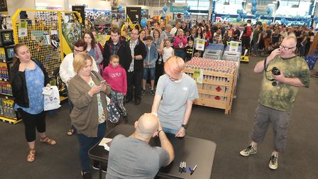 BAFTA award winning actor Ross Kemp signs autographs for his many fans at the opening of the new Go