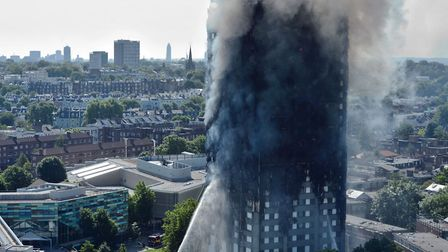 Smoke billows from the fire that engulfed the 24-storey Grenfell Tower in west London. Picture: VICT