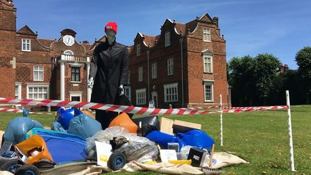 The fly tip with the 'Faceless' fly tipper in front of the Christchurch Mansion