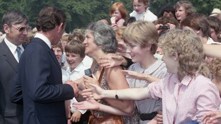 Prince Charles meeting and signing autographs on his visit to Ipswich