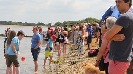 Spectators lined the shore to cheer on those taking part in the Great East Swim at Alton Water. Pict