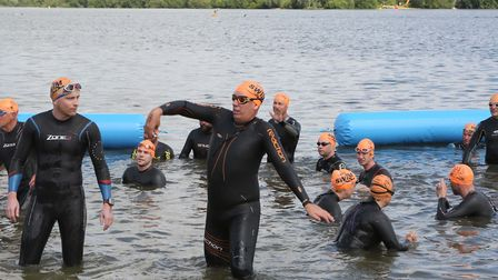 Limbering up ahead of the Great East Swim at Alton Water. Picture: SEANA HUGHES