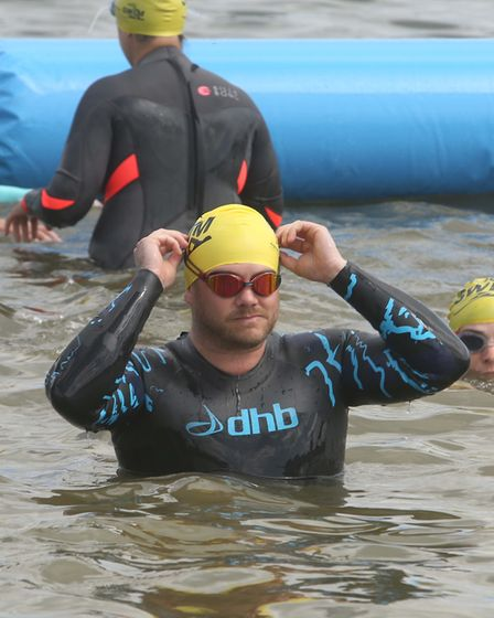 One of thousands of people who headed to Alton Water to take part in the Great East Swim. Picture: S