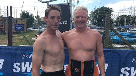 Rob Milburn and Simon Emm from Colchester were first to finish in the10k swim. Picture: ADAM HOWLETT