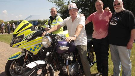 Geoff Lusher, second from left, with PC Kevin Stark, son Mark Lusher and Colin Snowden, owner of bi