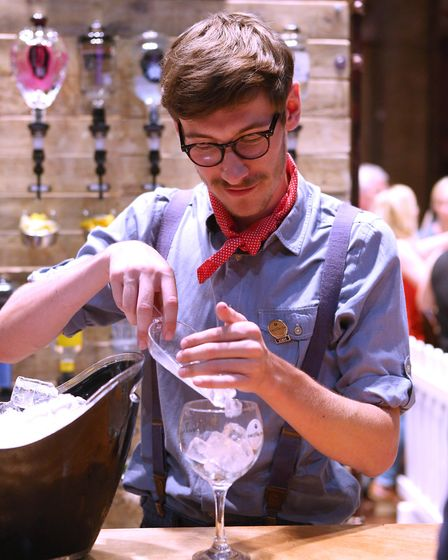 A bartender creates a gin tipple at Ipswich Town Hall. Picture: RICHARD MARSHAM/RMG PHOTOGRAPHY