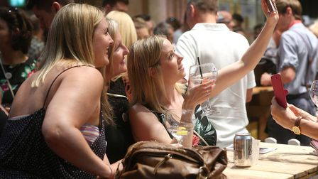 Visitors pose for a 'selfie' at the Ipswich gin festival. Picture: RICHARD MARSHAM/RMG PHOTOGRAPHY