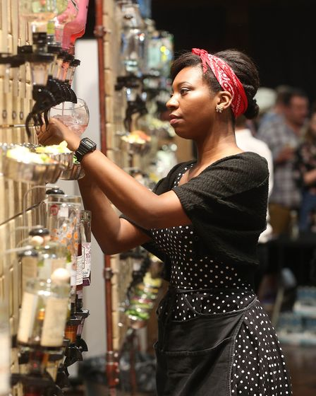 Staff at work at the Ipswich gin festival at the Town Hall. Picture: RICHARD MARSHAM/RMG PHOTOGRAPH