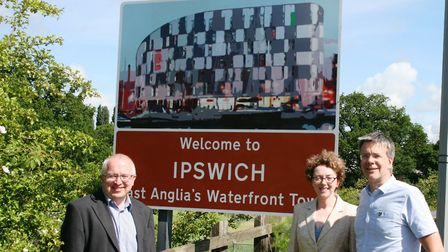 From left: David Ellesmere, Ipswich Mayor Sarah Barber and Paul West at the sign at Bourne Bridge. P