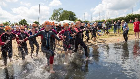 Hundreds of swimmers test out Alton Water at a training day ahead of the Great East Swim. Picture: M