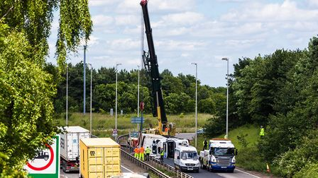 A crane was used to move the lorry after an accident at the A14 Dock Spur roundabout in Felixstowe.