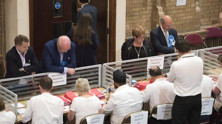 Candidates watch over the count. Picture: ASHLEY PICKERING