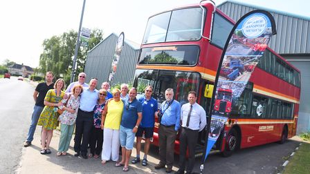Friends and family gather at Ipswich Transport Museum for the unveiling of a bus in honour of Jim Lo