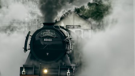 Train bursting through the steam. Picture: FRED IXER