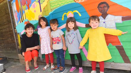 Artist Joy Pirkle painted a giant mural to promote healthy eating at Quayside Nursery Bright Horizon