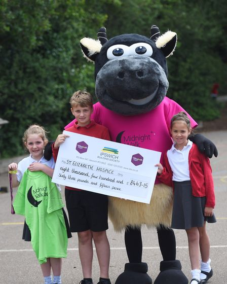 St Elizabeth Hospice's mascot Woolly the Sheep receives the �8,000 raised by Broke Hall Primary Scho