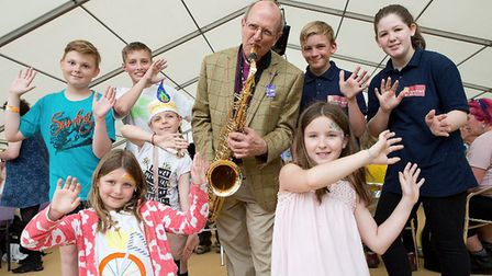Rt Revd Martin Seeley showed youngsters his love of the saxophone on day one of the Suffolk Show. Pi